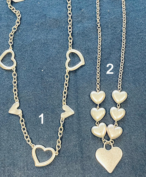 Costume jewellery- short silver coloured necklaces