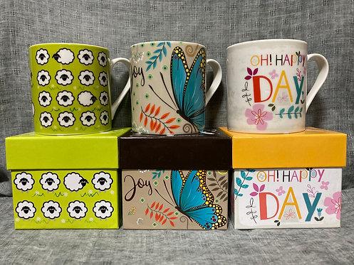 Bright designer boxed mugs