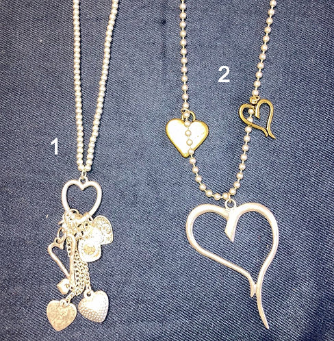 Costume jewellery - long silver colour heart necklaces