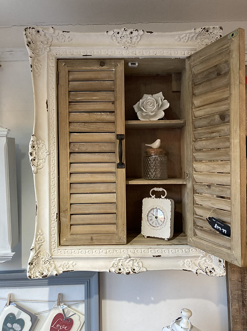 Shuttered wall cabinet