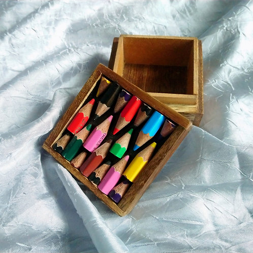 Small wooden box inlaid with coloured pencils