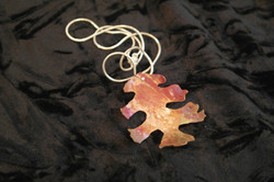 Single maple leaf on silver cord