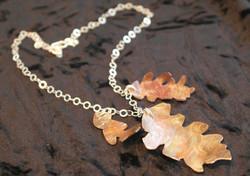Tri-oak charm on silver