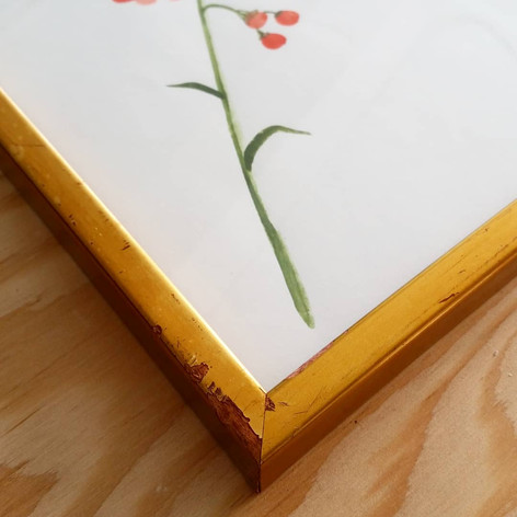 The perfect re-claimed wood frame with gold finish and peek-a-boo red to compliment the red flowers in this painting.
