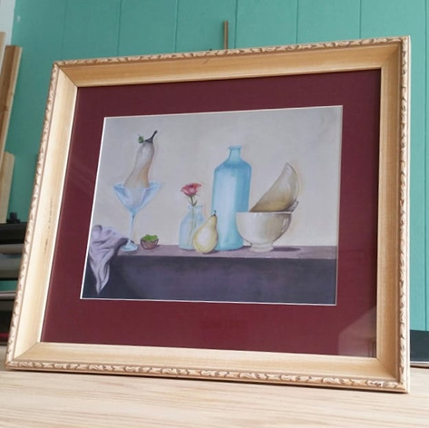 The perfect frame for re-loving and a wine-berry mat that speaks to the work of Brittany Kornel, a local Winnipeg artist.