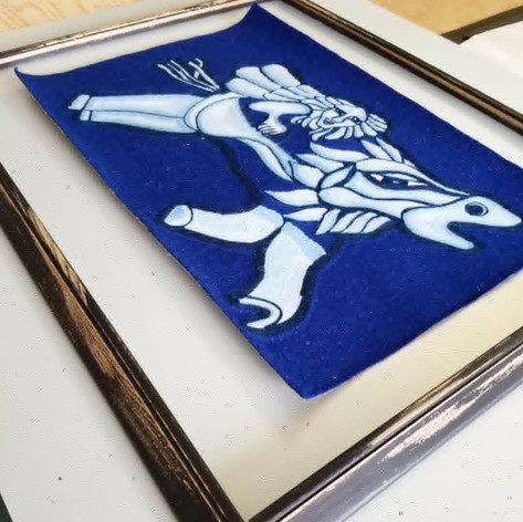 Re-purposed black-painted wood frame with hand stressing to give an artisinal feel with a semi-metalic light blue mat for this amazing textile from Chile.