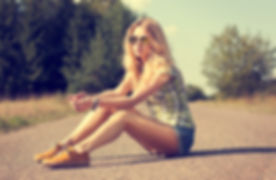 Girl Sitting on the Path