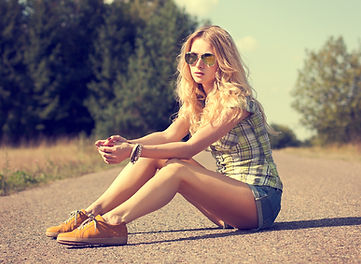 women with smooth legs sitting on road