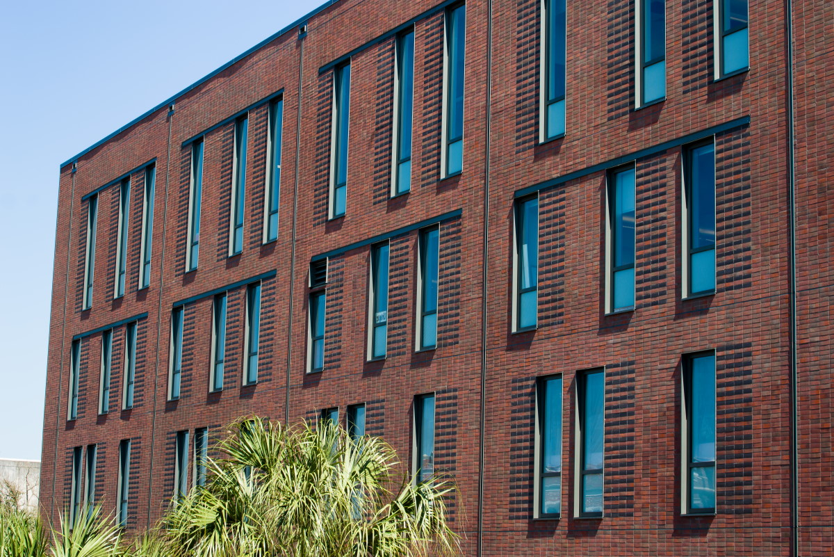 corium brick cladding Monroe Hall, LA-1.