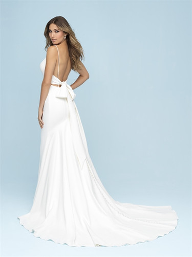 sexy low back wedding gown with a bow on the back