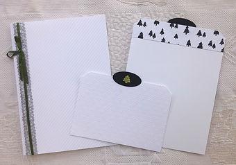 album noël,sapin,boules de noël,blanc,noir,vert olive,ruban,paillettes,cloches,cadeau