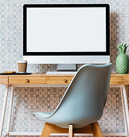 Photo of an empty chair at a computer desk.