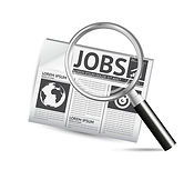 Image of newspaper with magnify glass looking at jobs category.