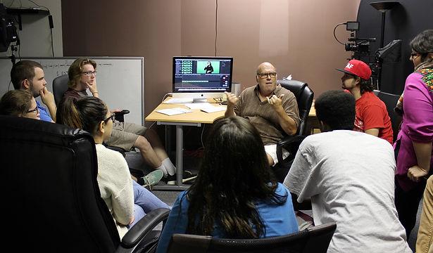 Photo of Anselmo DeSousa teaching Deaf Youth