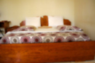 Hotel room with queen bed in Huye, Rwanda