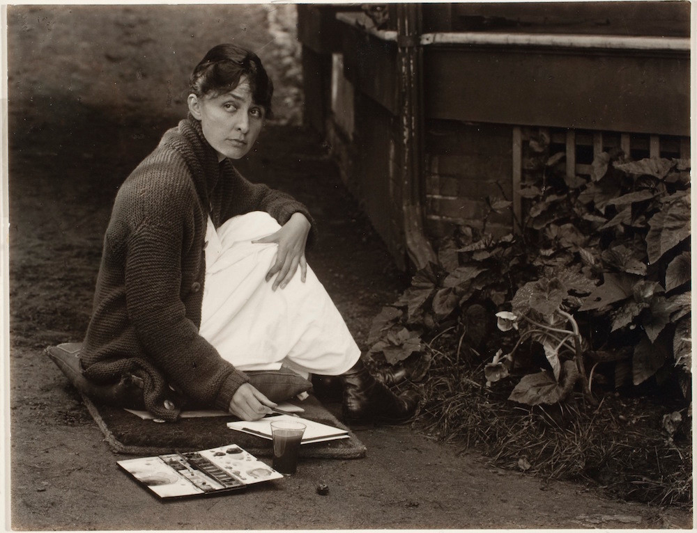 Alfred Stieglitz, Georgia O'Keeffe with watercolor paint box, 1918. Gelatin silver print on paper. George Eastman Museum, purchase and gift of Georgia O'Keeffe, Courtesy George Eastman Museum.