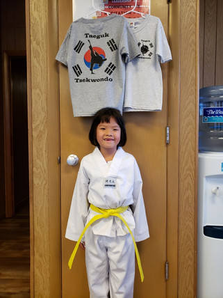 yellow belt girl smiling under tshirts