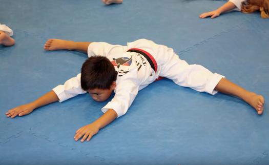 Kid doing the splits