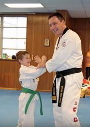 Master Hayes training small green belt child