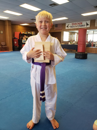 Purple belt after breaking a board