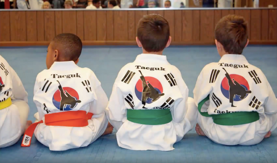 Yellow, green and orange belt sitting in a line