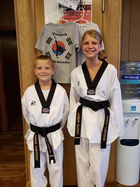 Black belt siblings under tshirts