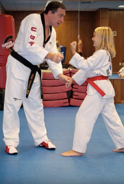 Master Hayes training orange belt girl