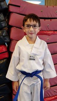 Blue belt kid smiling
