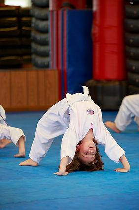 White belt doing back bends