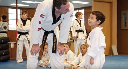 Master Hayes looking at a small boy