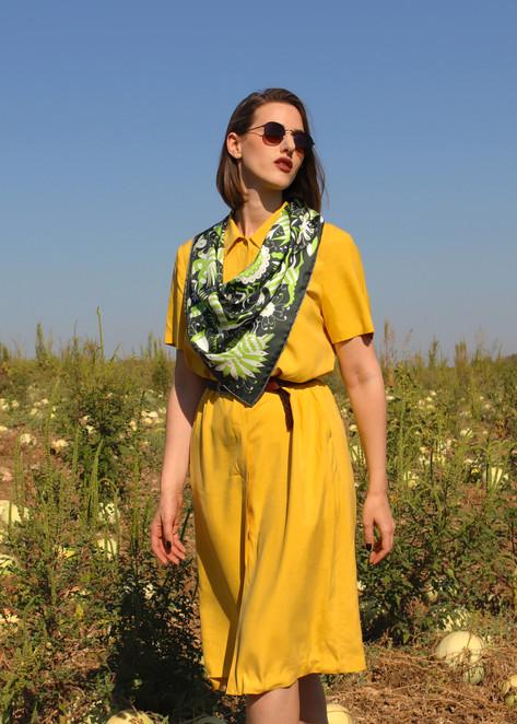 Noé verdure, anath silk fashion, silk scarf, silk twill, green, 100% silk, hand rolled edges, made in italy, wraped around the neck, model standing