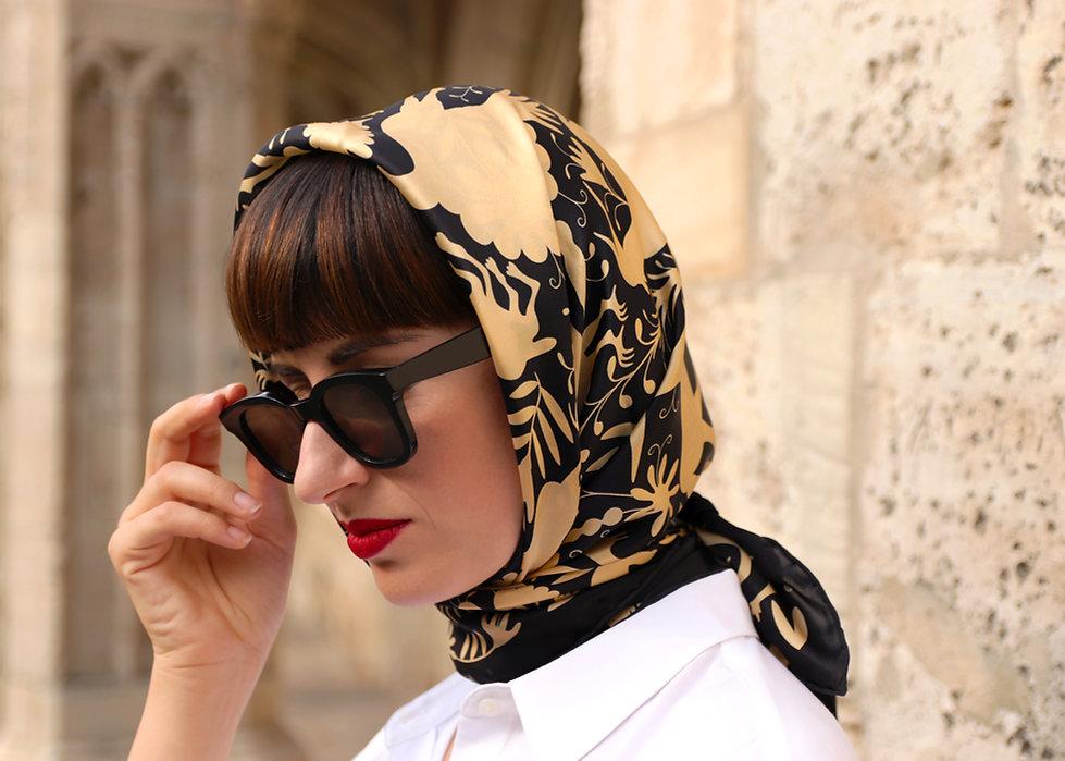 ANATH silk fashion, NOÉ gold, tribal pattern, geometric design, limited edition, designer silk scarf, grace kelly head scarf, audrey hepburg head scarf, how to wear a scarf, how to tie a hair scarf, black and gold, silk satin, head scarf ties,