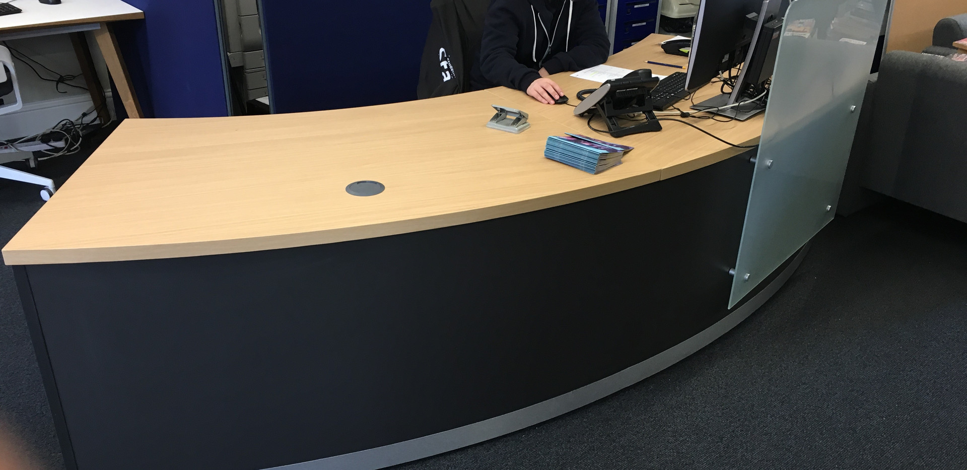 Curved desk with privacy screen