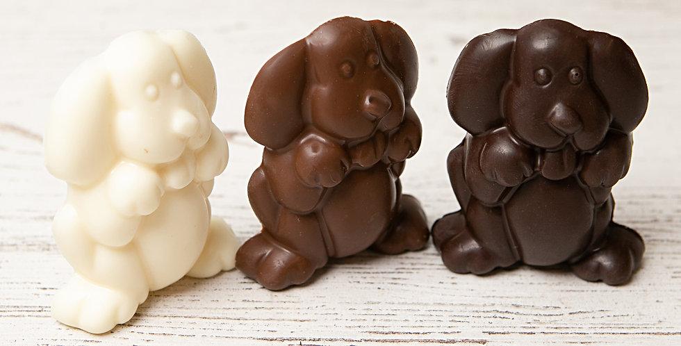 Solid chocolate dog in dark chocolate, milk chocolate, or white chocolate