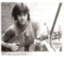 Part of a series of publicity photos I did in a cheap 42d Street photographer's studio in New York City in 1976, I had little idea that two of the main themes of my life decades later came together in that photo:  The guitar and the Shell Oil T-shirt....