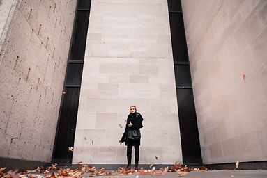 Portrait of a woman infront of Brutalist architecture.jpg
