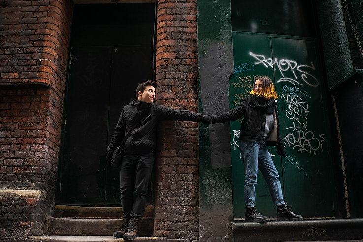 Couple photography. Couple is holding hand on a street