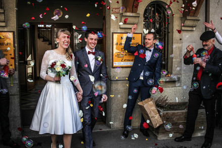 Wedding photograph of a couple coming out of a registry office