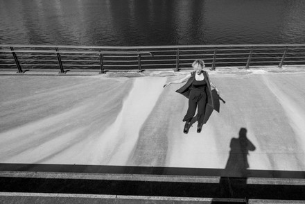 Black and White portrait photo of a woman on a river bank in Manchester
