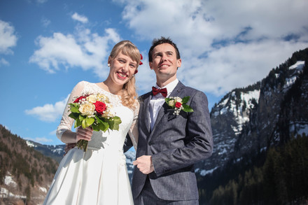 A portrait of a young couple on their wedding in mountains at a sunny day