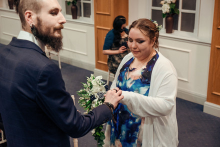 A couple getting married in manchester's registry office, portrait wedding photo by Fedor Vasilev