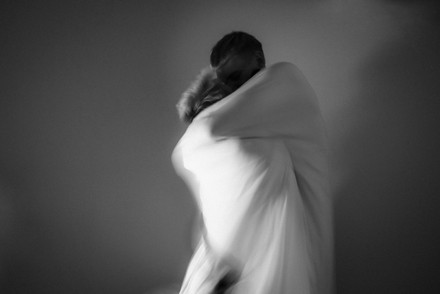 A black and white photo of a couple hugging in movement
