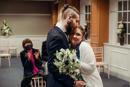 The Newlyweds hug each other on their wedding in manchester's registry office, portrait photo by Fedor Vasilev