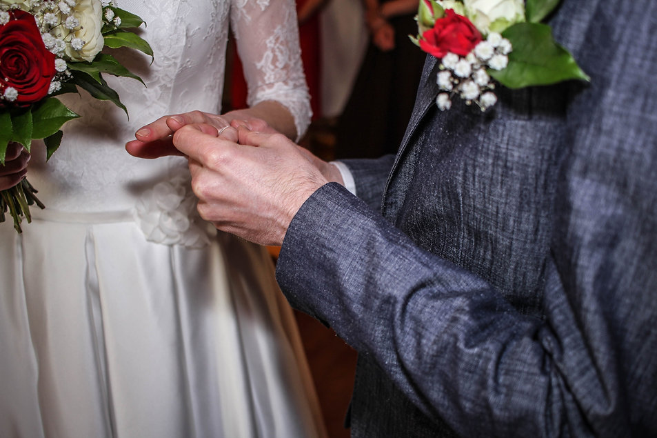 Putting on the rings in the ceremony.jpg