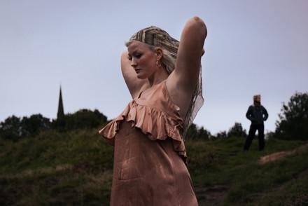 Potrait photo of a woman in a park