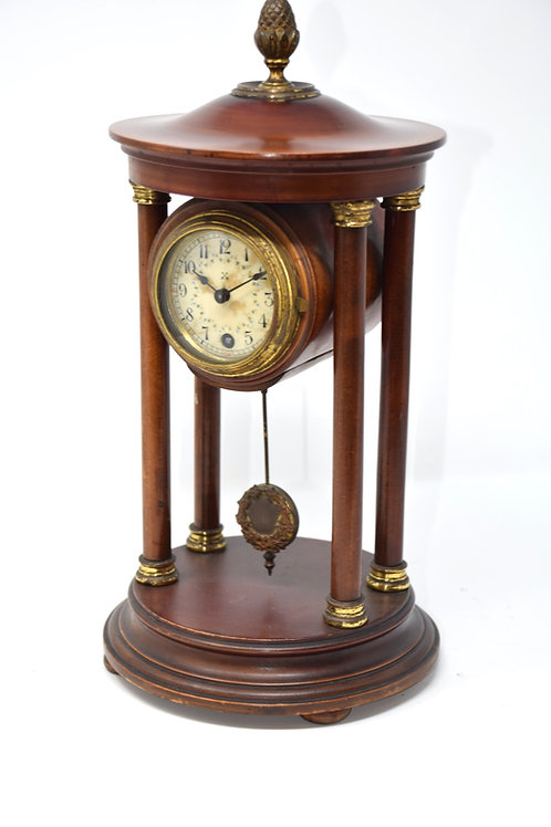 Pillared 8 day timepiece spring table clock.
