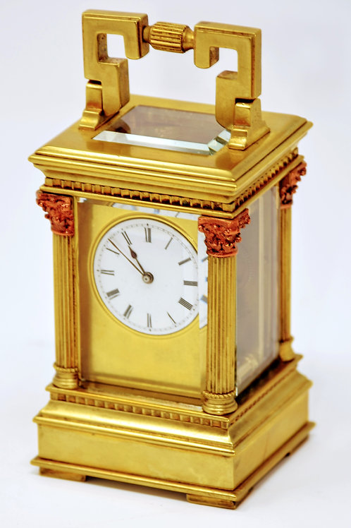 Miniature 8 day French carriage clock.