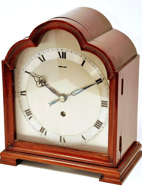 A triple caddy top, timepiece spring table clock.