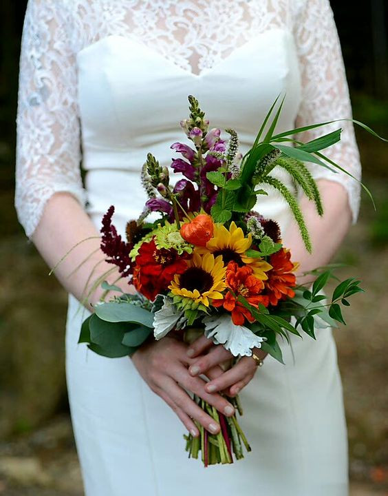 deep orange and yellow august wedding bouquet