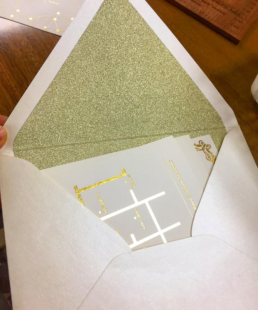 Gold foil invitations + gold glitter envelope liner